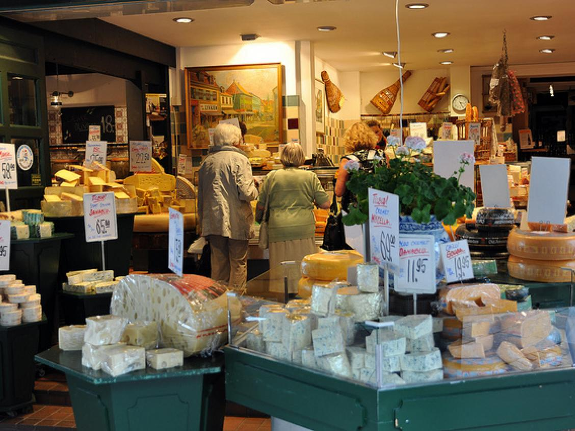 Photo shows a display of cheeses