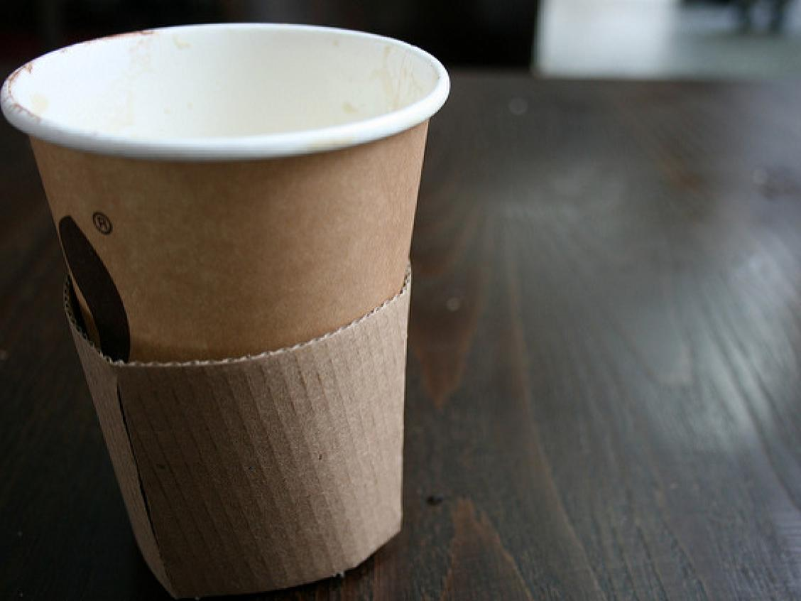 Photo shows an empty paper-based coffee cup