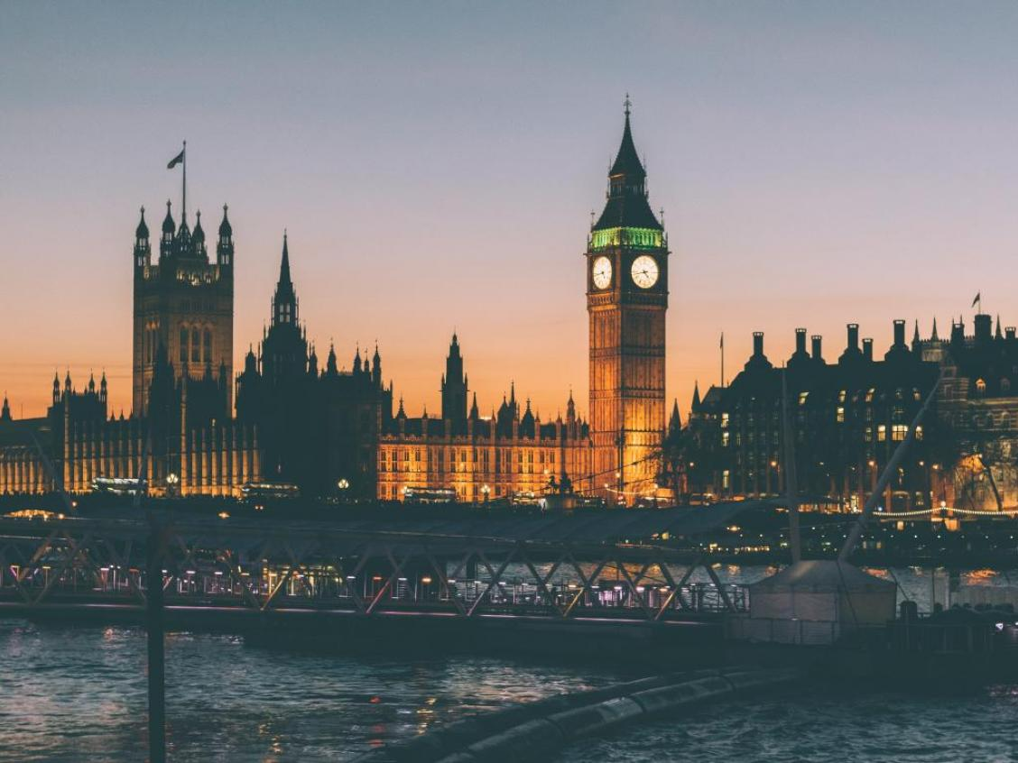 Photos shows the UK's Houses of Parliament at dusk