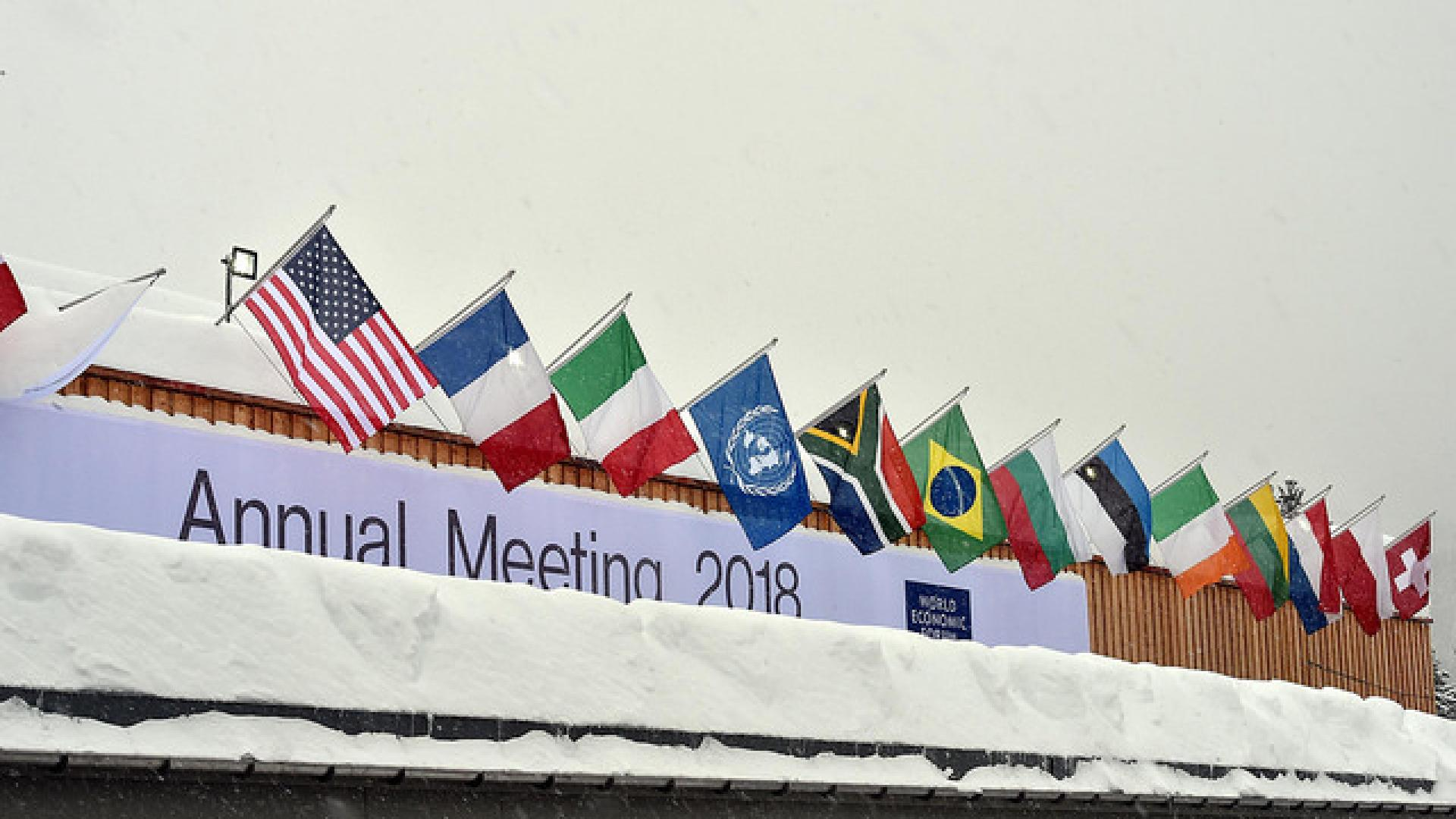 Photos shows World Economic Forum meeting venue in the snow with flags