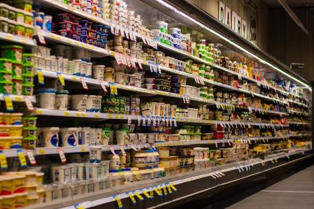 Image shows a supermarket shelf of dairy products (containing hidden soy)